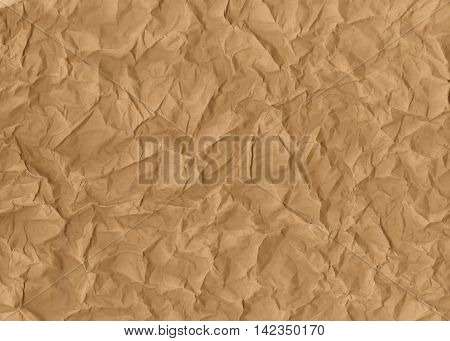 Texture of a crumpled brown paper, wallpaper, background