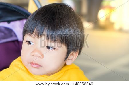 Japanese Boy with eye full of tears crying