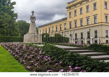 OSLO, NORWAY - JULY 1, 2016: This is monument to Norway's Queen Maud of Wales at the entrance to the park of the Royal Palace.