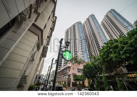Bangkok, Thailand - October 27, 2015: Sukhumvit on October 27, 2015. A Star Buck sign is brightly light up in the street of Bangkok Luxury residential area.