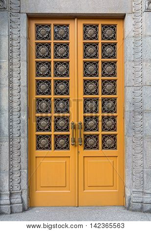 Yellow door in a classic style. Architecture