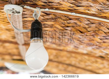 Dusty ceiling light bulb in Rural wooden hut