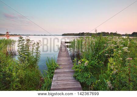 wooden pier on big lake in summer Groningen Netherlands