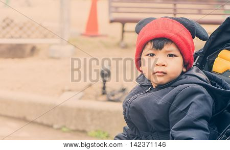 Asian Boy wearing a winter clothes with copy space