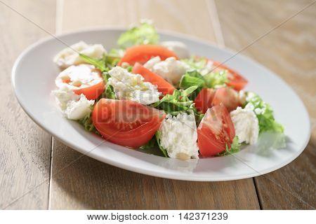 salad with tomatoes, mozzarella, rocket salad and cedar nuts, non standart caprese