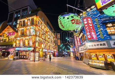 Osaka, Japan - March 11, 2016: Shinseikai street is one of the most lively night life scene in Osaka. It is located near the Tsutenkaku tower