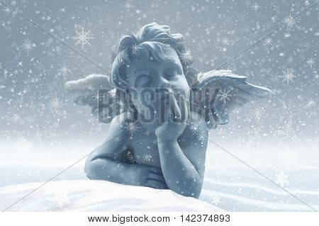Little guardian angel in the snow -christmas decoration
