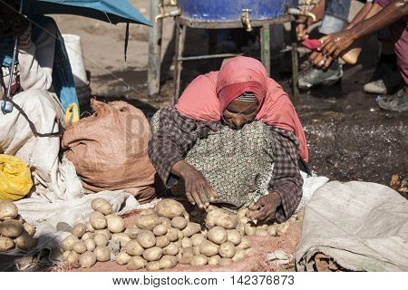 ADDIS ABABA, ETHIOPIA-OCTOBER 31, 2014: An unidentified merchant sells potatoes on the side of the road in Addis Ababa, Ethiopia