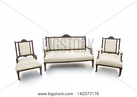 Old fashioned wood chair and sofa on white background.