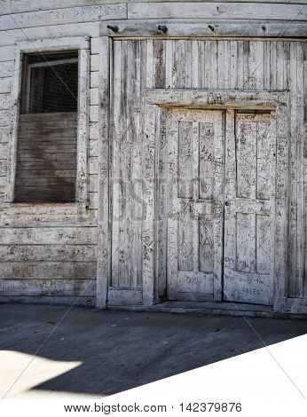Dilapidated Store Front with Names carved into the Wood