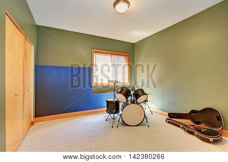 Rehearsal Room With Drums And Guitar.