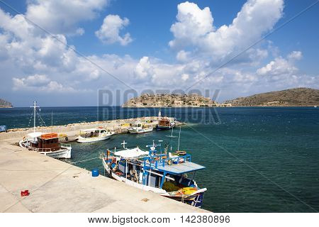 CRETE ISLAND, GREECE - JUNE 20, 2016: View from pier to the fortress island of Spinalonga, Crete island, Greece, June 20, 2016