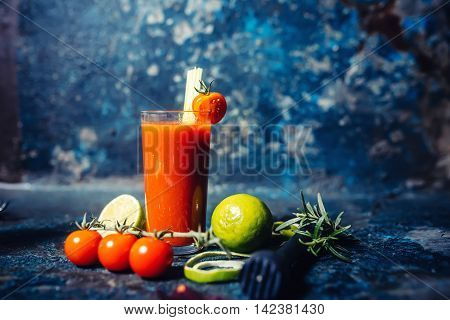 Spicy Bloody Mary Cocktail Served On A Dark Bar Garnished With Cherry Tomatoes