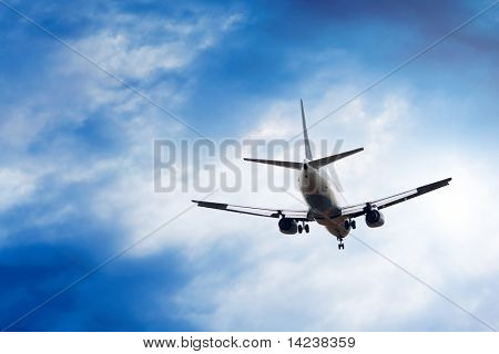 Airplane on the blue sky