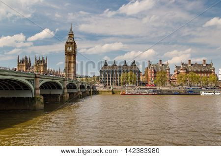 LONDON - May 06: London and Westminster Bridge near Parliament on May 06 2016 in London UK. London is one of the world's leading tourism destinations.