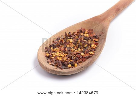 Calabrian pepper. Dry pepper into a spoon in white background