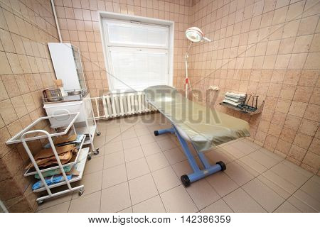 RUSSIA, MOSCOW - AUG 31, 2015: examination office with medical observation couch in multidisciplinary Clinic Center Endosurgery and Lithotripsy (CELT)