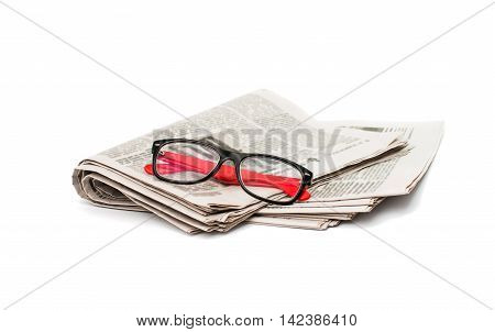 newspaper with glasses closeup on white background
