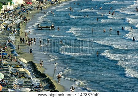 KUSADASI; Turkey - MAY 20; 2016: People on beach of Kusadasi. Editorial image