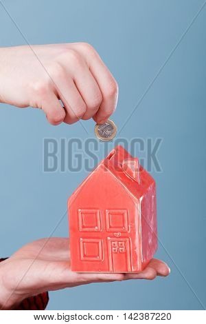 Male Hand With Little House And Silver Coin.