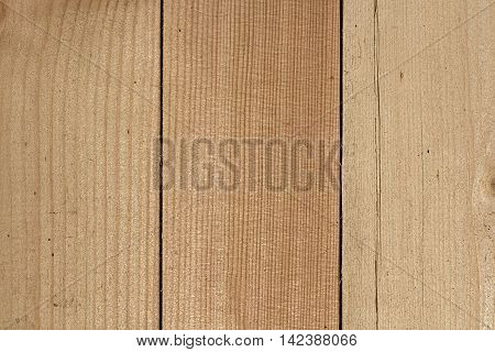 Three close lying pine boards. The texture of natural wood. Wooden background for posters, banners, web design. Close up image