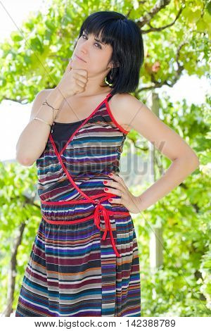 young casual woman posing, outdoors