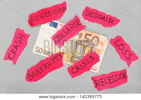 Euro banknote with paper red negative marks. Creative money concept