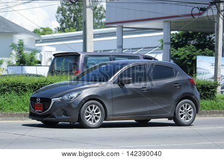 CHIANGMAI THAILAND -JULY 27 2016: Private Eco car Mazda 2. On road no.1001 8 km from Chiangmai Business Area.