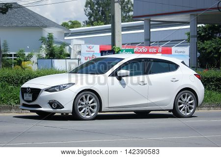 CHIANGMAI THAILAND -JULY 27 2016: Private Eco car Mazda 3. On road no.1001 8 km from Chiangmai Business Area.