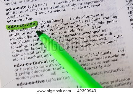 The word education is defined and highlighted in a dictionary.