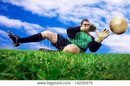 Jump of football goalman on the outdoor field