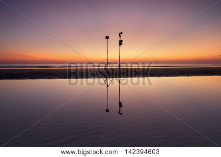 reflection of two reflectors on a Thailand beach