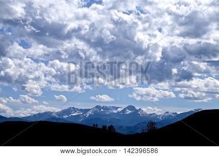 Trees silhouettes, mountains and clouds. North Cascades National Park Winthrop Washington State USA.