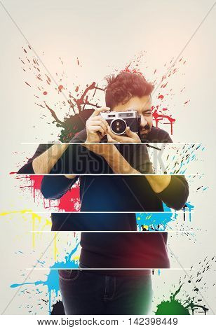 Close up portrait of a photographer guy holding vintage camera Abstract Photo
