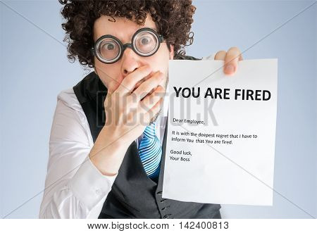 Shocked Man Is Showing Letter With You Are Fired Message.