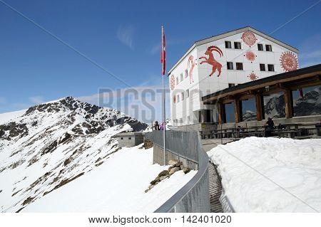 DIAVOLEZZA, SWITZERLAND - MAY 27, 2016: Alpine scenery at Diavolezza facing the Bernina Massive and Morteratsch Glacier on May 27, 2016 in Switzerland. It is a landmark ski resort near Saint Moritz.