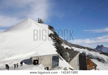 Jungfraujoch, Switzerland - Nov 14, 2015: Jungfrau observatory and summit on Nov 14, 2015 at Jungfraujch, Switzerland. It is one of the most popular alpine destinations in Switzerland.