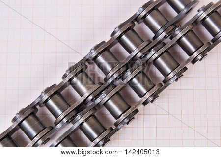 Industrial driving roller chain on graph paper