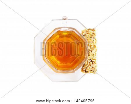 cup of herbal tea and organic granola on white background with clipping path. Healthy diet food. Above view.