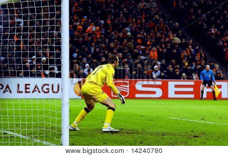 DONETSK, UKRAINE - FEB 25: Mark Schwarzer in match UEFA Europa League between FC Shakhtar(UKR) vs. Fuham FC(ENG) at Donbass Arena stadium February 25, 2010 in Donetsk, Ukraine.