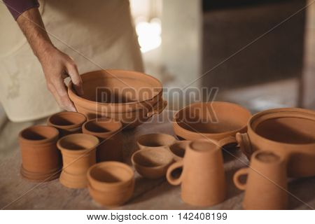 Various pottery on table in pottery workshop