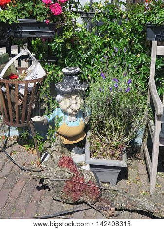 Female garden gnome in Dutch village of Urk