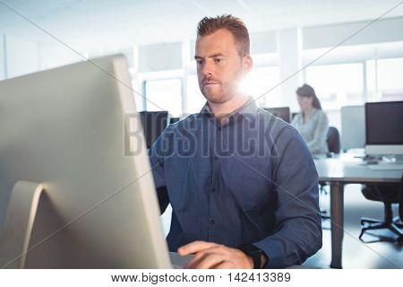 Mature students using computer in the computer room