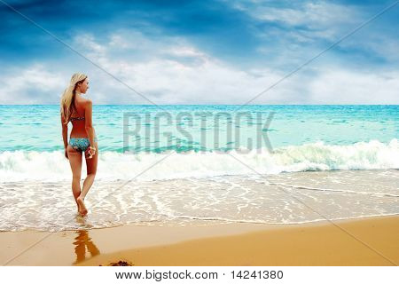 Young beautiful women on the sunny tropical beach in bikini
