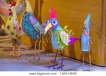 GIRONA SPAIN - JULY 6 2016: Roosters souvenirs made of sheet metal on the old street in Girona Spain