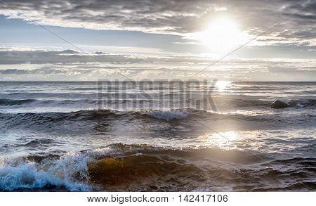 sunrise on the lake with big waves
