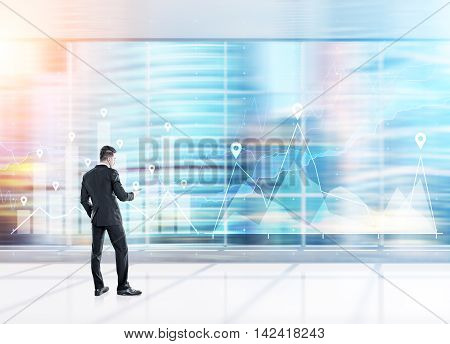 Businessman analyzing company statistics in blurred panoramic office. Concept of good specialist. Toned image. Double exposure.