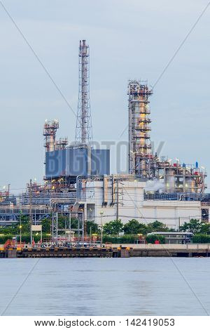 Heavy oil industrial factory river front. manufactuting background
