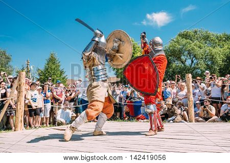 Dudutki, Belarus - July19, 2014: Historical restoration of knightly fights on festival of medieval culture. Knights In Fight With Swords