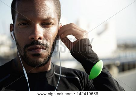Portrait Of Purposive Fitness Trainer Preparing Himself For Tough Workout. With Serious Face, Tracke